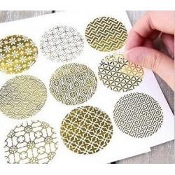 270 Etiquetas adhesivas redondas, transparentes con motivos dorados.